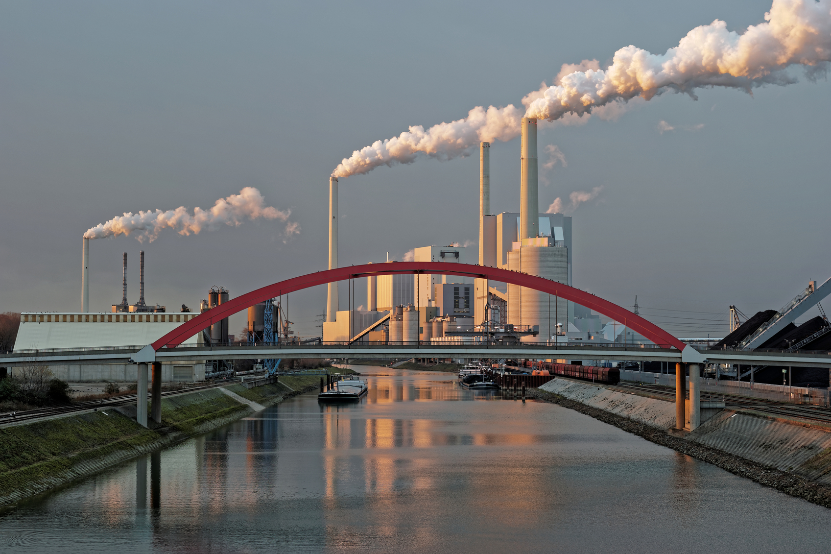 Coal-fired power plant at the shore of the Rhine as seen from a footbridge in Mannheim in Germany.